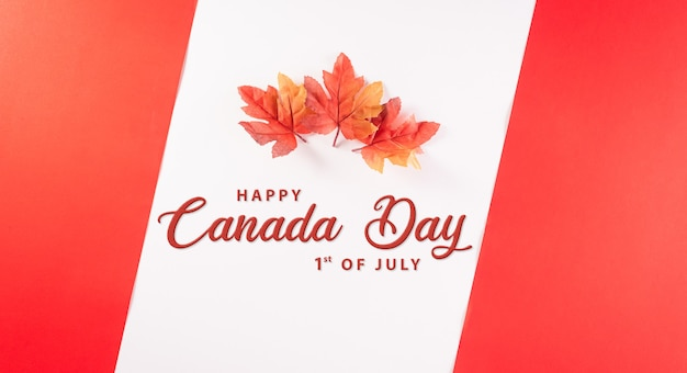 Happy canada day concept made from red silk maple leaves with the text on white and red background