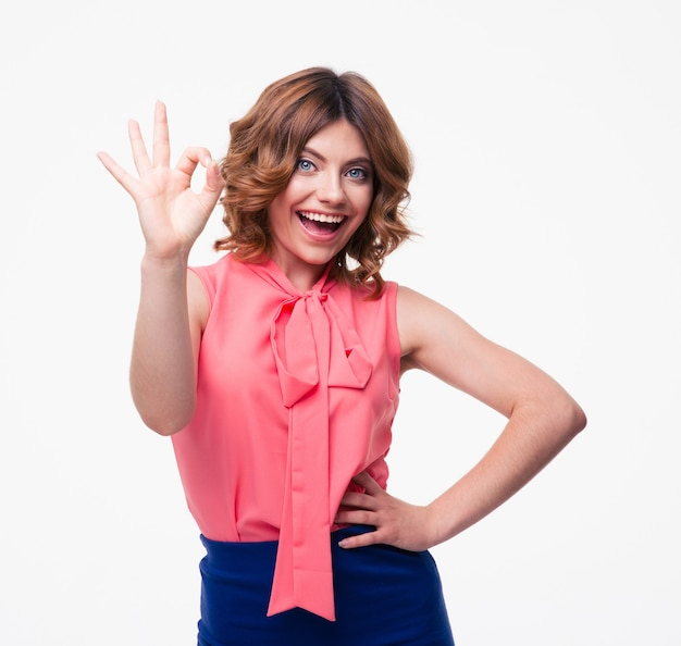 Happy casual woman showing ok sign
