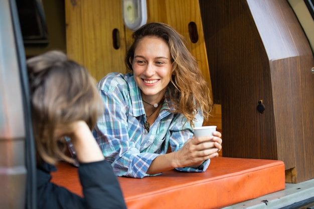 Happy caucasian beautiful woman traveler people enjoy coffee morning nature vacation in camping car