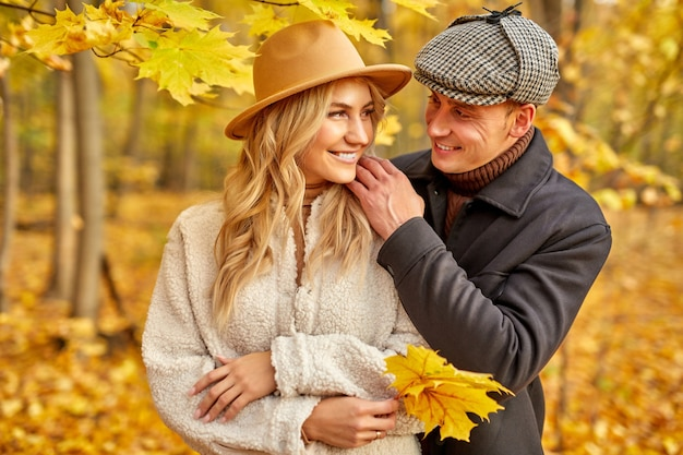 Happy caucasian family couple enjoy being in autumn nature