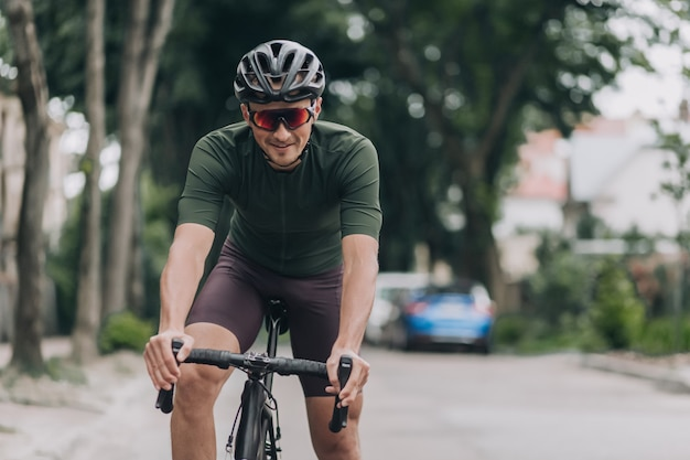 Happy caucasian man cycling alone on city street