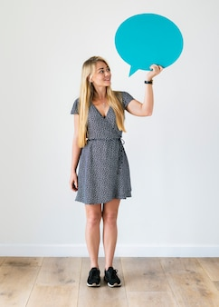 Happy caucasian woman holding copyspace speech bubble