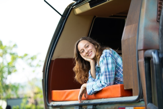 Happy caucasian woman traveler people enjoy nature vacation in car