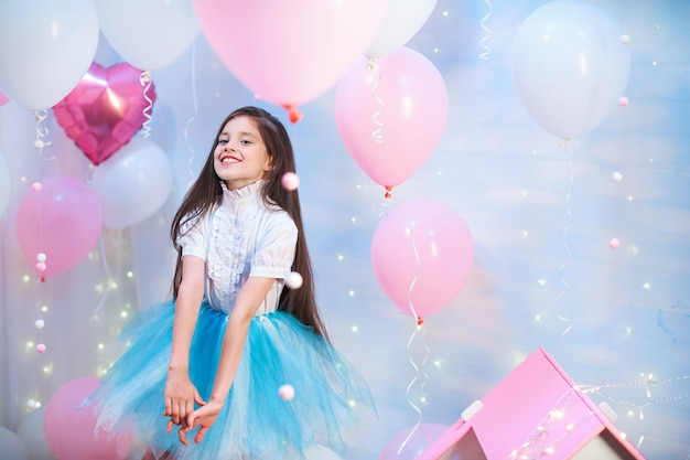 Happy celebration of birthday party with pink helium balloons cute little girl