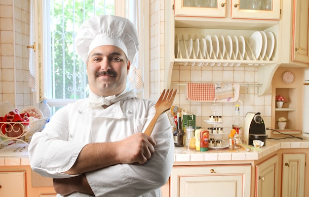Happy chef in the kitchen