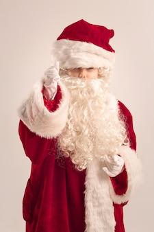 Happy child in a oversize santa claus costume