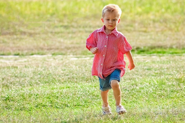 Happy child playing in nature in summer