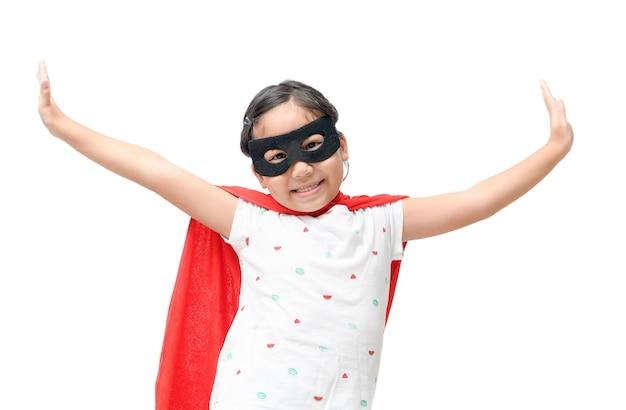 Happy child plays superhero isolated on white