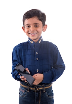 Happy child using cell phone on white background.