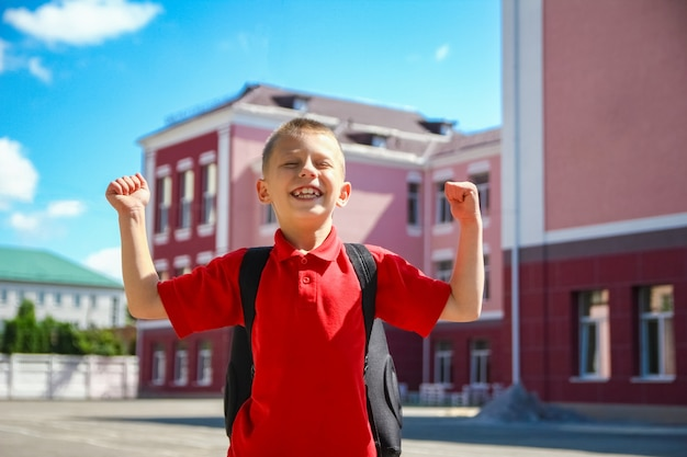 A happy child walking to school on the way back to school