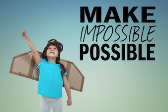 Happy child with cardboard wings and inspirational phrase