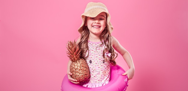 Happy child with pineapples on colored background