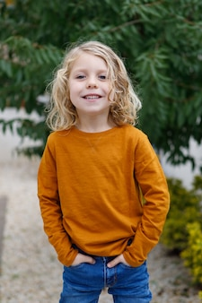 Happy child with red t-shirt in the garden