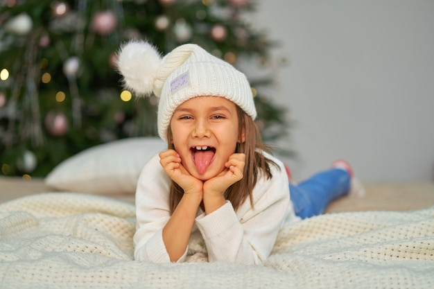 Happy childhood, christmas magic fairy tale. little girl waiting for christmas and holiday gifts.
