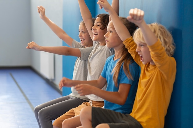 Happy children enjoying their gym class