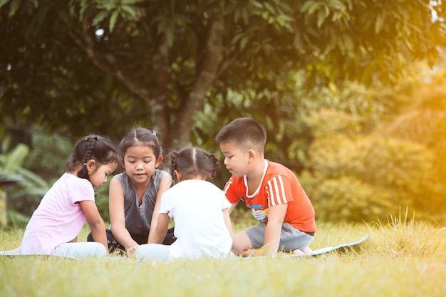 Happy children playing and having fun together in outdoor in summer time
