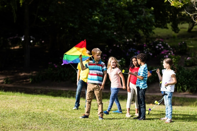 Happy children playing with a kite