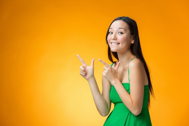 Happy chinese girl on yellow