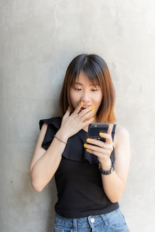 Happy chinese teenager  girl talking mobile phone with smiling face