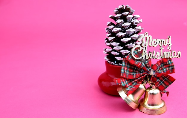 Happy christmas message on pink background.