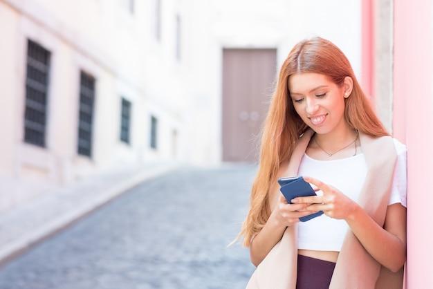 Happy city girl surfing net on smartphone