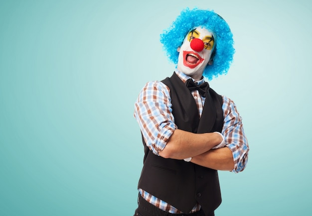Happy clown with crossed arms