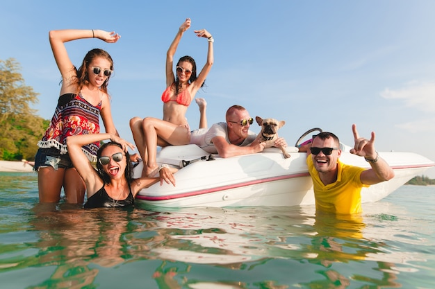 Happy company of friends on summer tropical vacation in thailand traveling on boat in sea, party on beach, people having fun together, men and women positive emotions