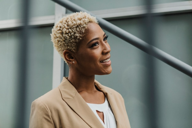Happy confident black businesswoman by the steps