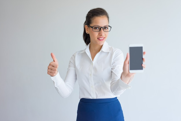 Happy confident businesswoman showing gadget screen and thumb up.