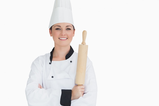 Happy cook holding a rolling pin