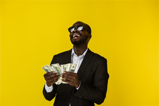 Happy cool man enjoys the money