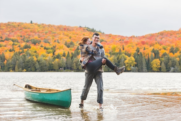 Happy couple after canoe trip at lake in canada