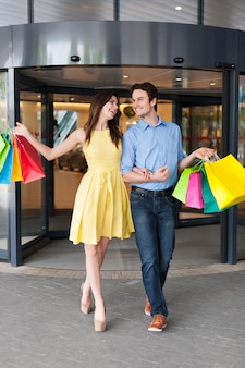 Happy couple after a successful shopping