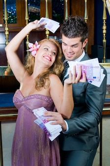 Happy couple after winning a lot of money in the casino