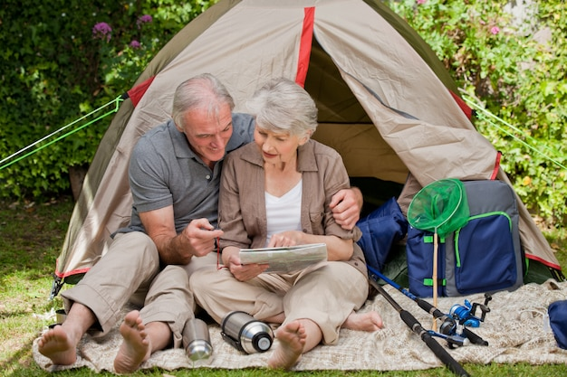 Happy couple camping in the garden