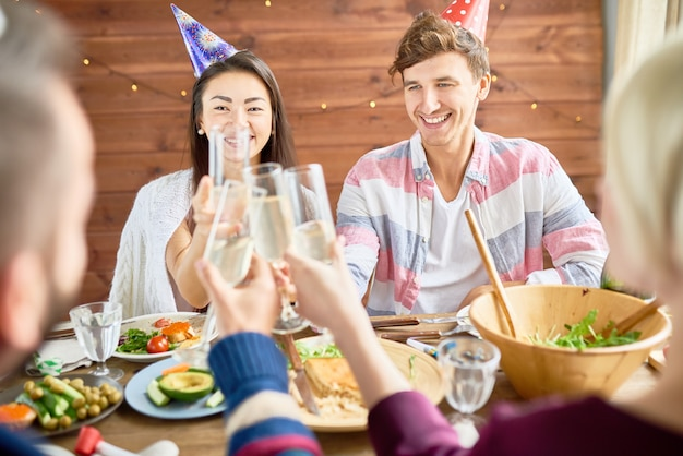 Happy couple celebrating birthday at dinner
