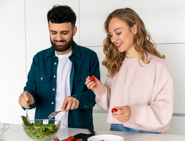 Happy couple cooking together at home