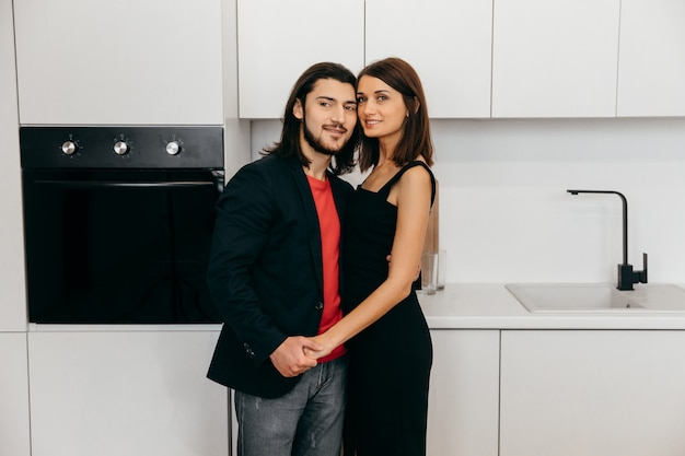 Happy couple cute touch each other in the kitchen. high quality photo