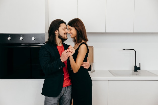 Happy couple cute touch each other in the kitchen