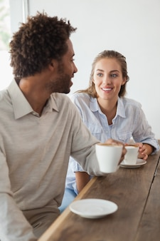 Happy couple on a date having coffee