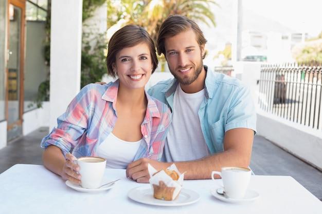 Happy couple enjoying coffee together