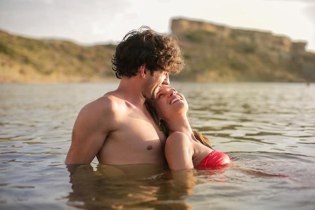 Happy couple enjoying the sea
