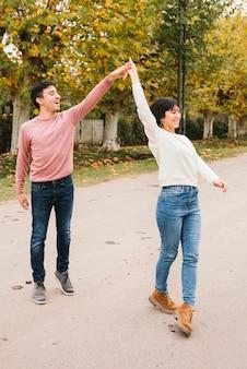 Happy couple flirting on street