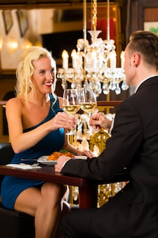 Happy couple have a romantic date in a fine dining restaurant