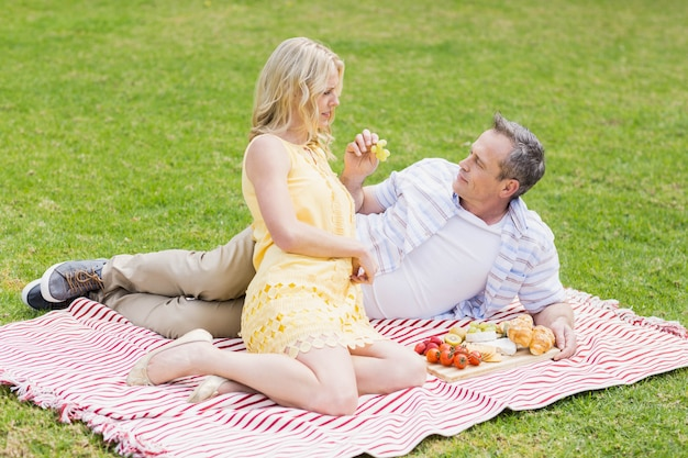 Happy couple having a picnic outside