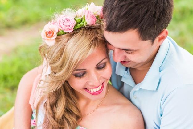 Happy couple having romantic picnic in countryside.