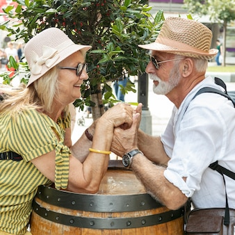 Happy couple holding hands on barrel