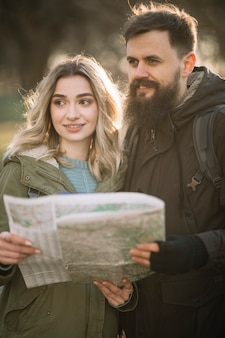 Happy couple holding map