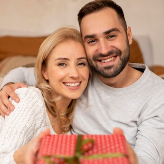 Happy couple holding present