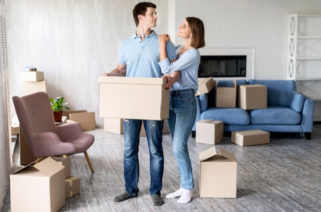 Happy couple at home on moving out day